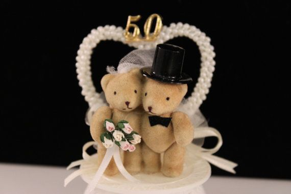 This adorable little bride and groom bear is perfect for a 50th Anniversary! Piece measures approx. 2 1/2 on the base and about 4 tall.