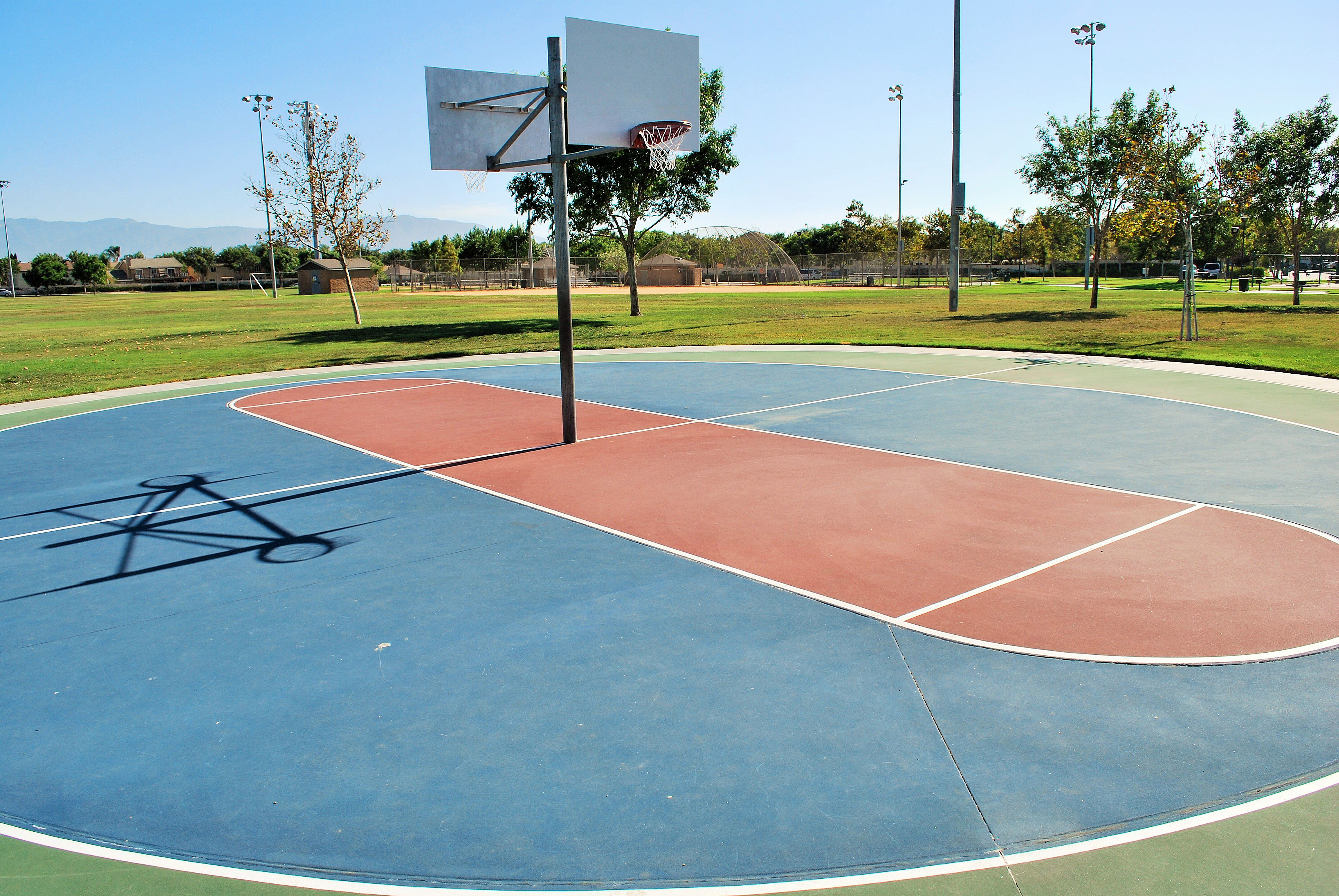 The Two Half Court Basketball Courts At Orchard Park In Eastvale California Playbasketball Http Youreastvalerealtor Com Eas Orchard Park Park Tennis Court