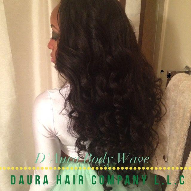 PinkandPrada showcasing D'Aura Hair Company body wave hair extensions.