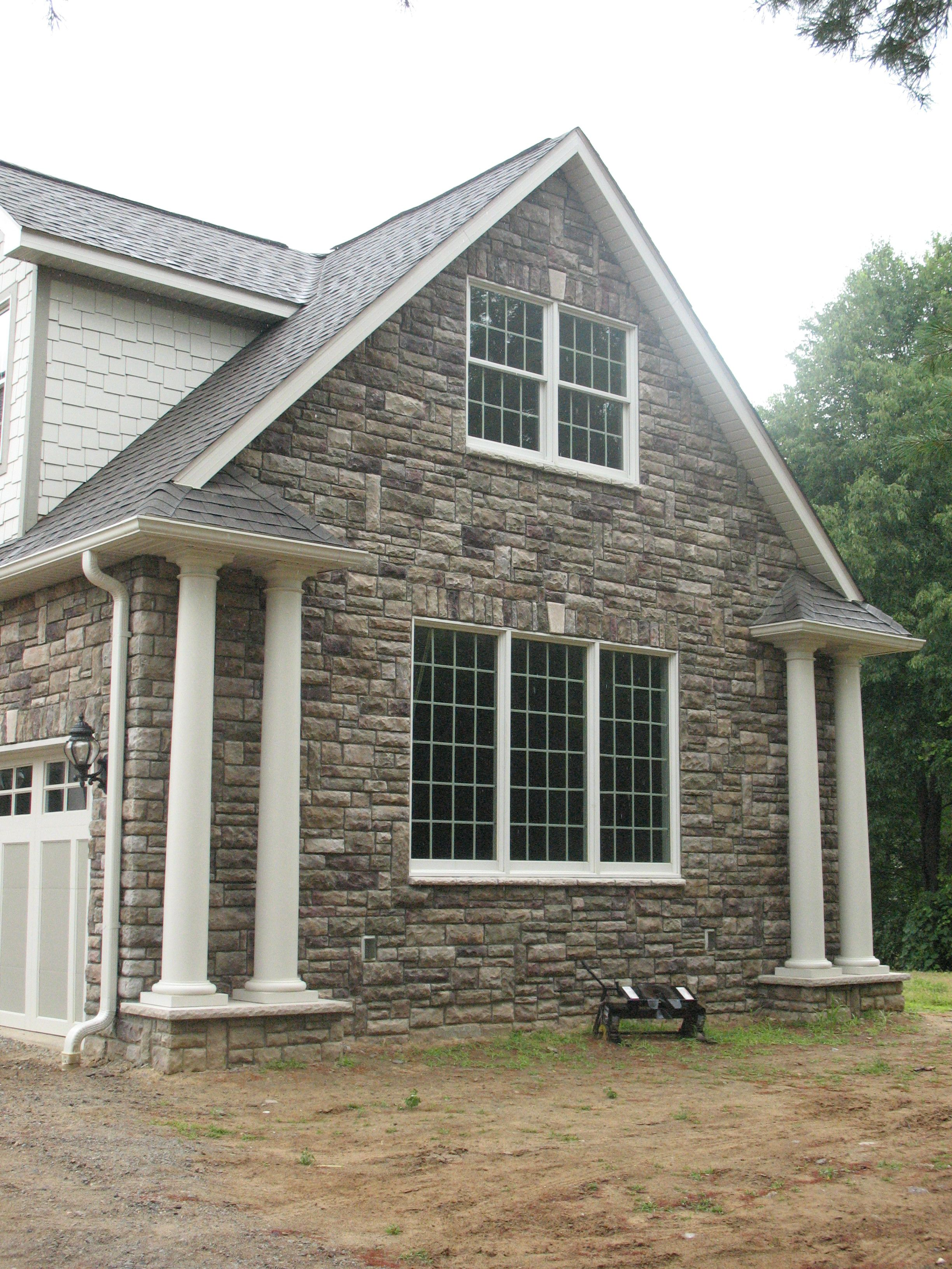 Bucks County Limestone From Boral Cultured Stone Installed By The Pros At Brighton Stone Fireplac Stone Exterior Houses House Paint Exterior Exterior Stone