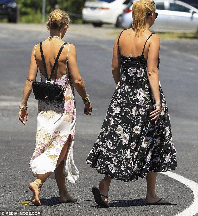Stunner: A plunging neckline and back hid her cleavage, but ensured her svelte physique wa...