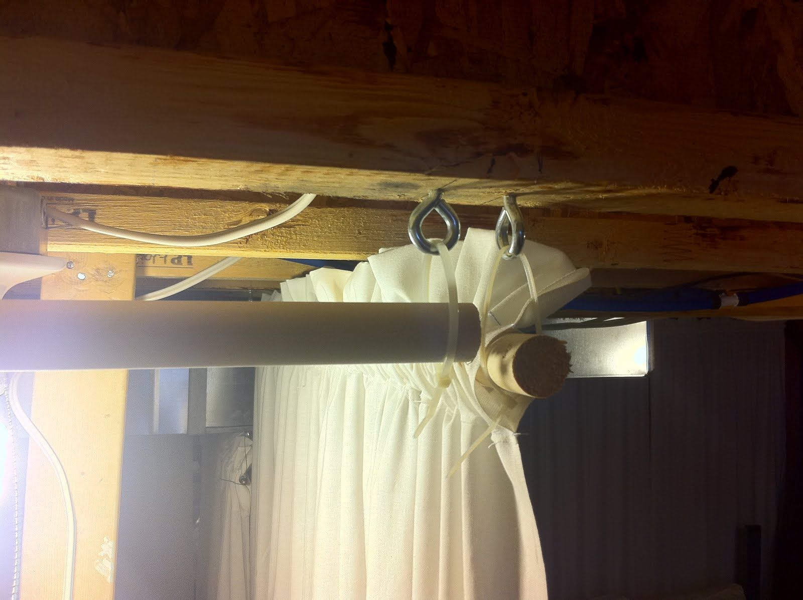 Uses Fabric Hooks Ties And Wood To Cover Walls Unfinished Basement Walls Curtains To
