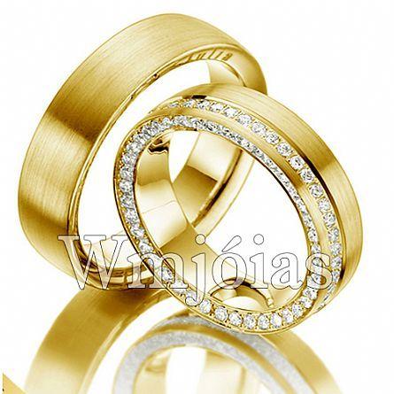 94bf6263e8a Alianças em ouro amarelo 18 kilates 750 modelo anatômico com 7 milímetros