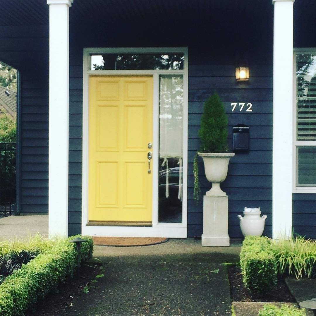 Yellow door painted color scheme exterior with dark exterior walls ...