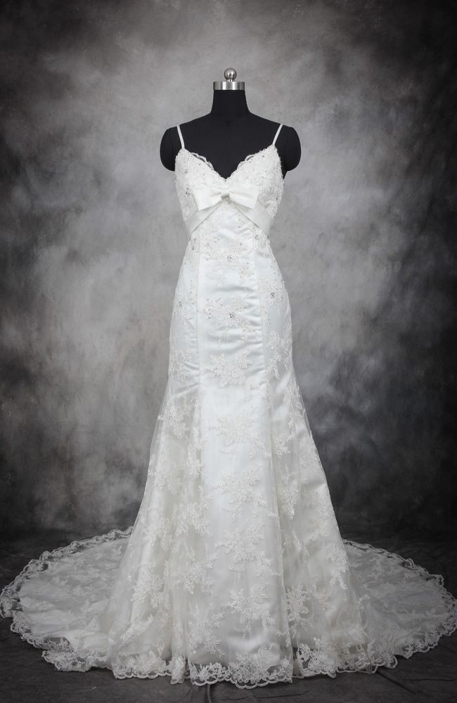 This perfect wedding gown is a great option for lace lovers! The princess style is romantic, pretty, and features lovelt decoration such as sequins and bows. Spaghetti Straps Front Bow Lace Wedding Dress Style Code: 11541 $269 Buy this wedding dress here: http://www.outerinner.com/spaghetti-straps-front-bow-lace-wedding-dress-pd-11541-0.html #WeddingDress #WeddingGown #OuterInner