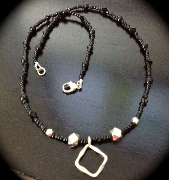 Black beaded and Sterling Silver Necklace by TropicOfCapricorn