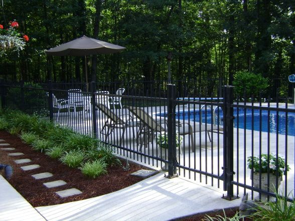 love the fence around pool and the flower beds | Backyard ...