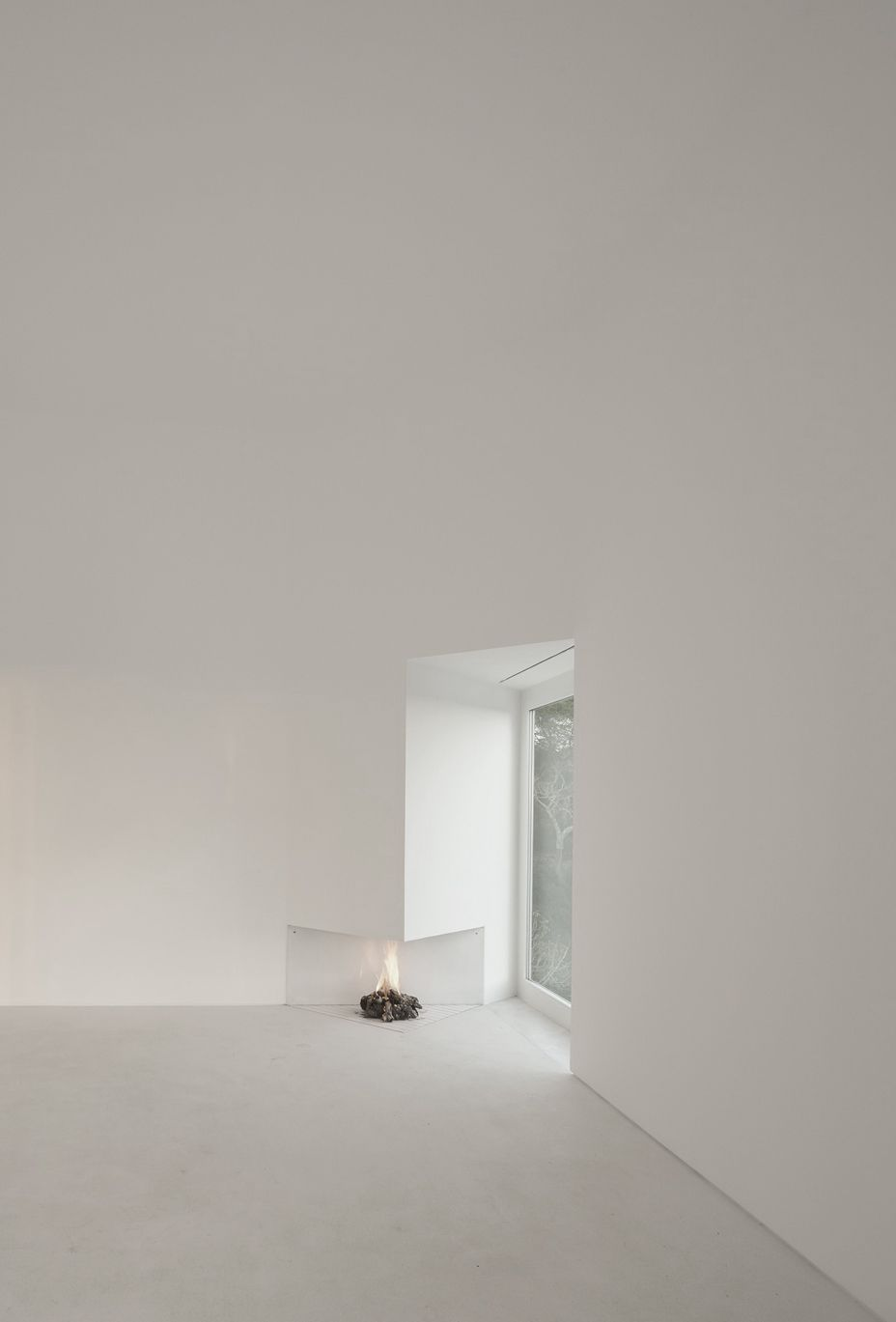 Triangular Fireplace in White Space