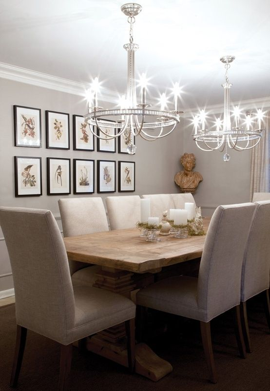 Reclaimed wood formal dining room table and two chandeliers