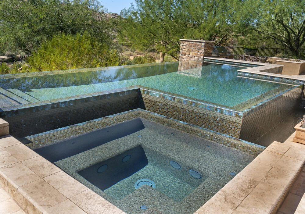 Interesting Elevated Pool And Patio Design With Hot Tub Overlooking  Sagebush Landscape.