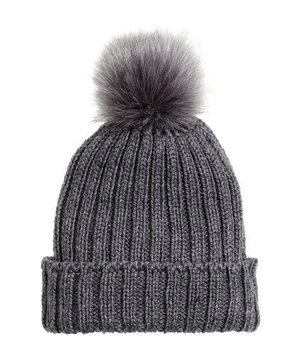 f1ffd2ea0501a Dark gray melange. Ribbed hat in a soft wool blend with a faux fur ...