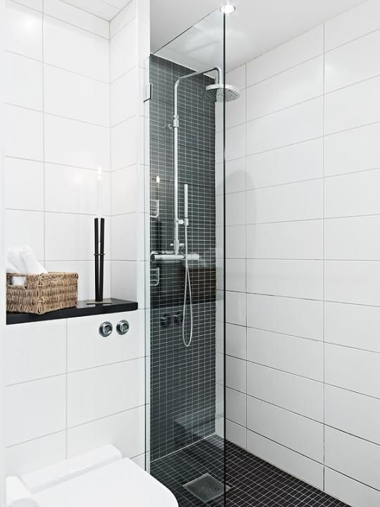 # Our size of bathroom. Like the Grey. A little too much white.Half glass on fixture side of shower is good.
