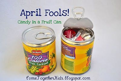 Open can from the bottom with a can opener, put candy inside, re-seal with hot glue.  This would be a fun surprise even not on april fools day