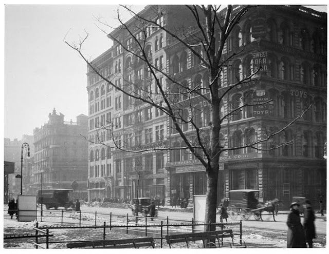 Horse-drawn and motorized vehicles share Union Square West in front of the Spingler Building on a snowy March 9, 1920 --photograph by Arthur Hosking, from the collection of the Museum of the City of New York