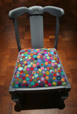 Wonderful felt applique seat cover by Ruth Singer.