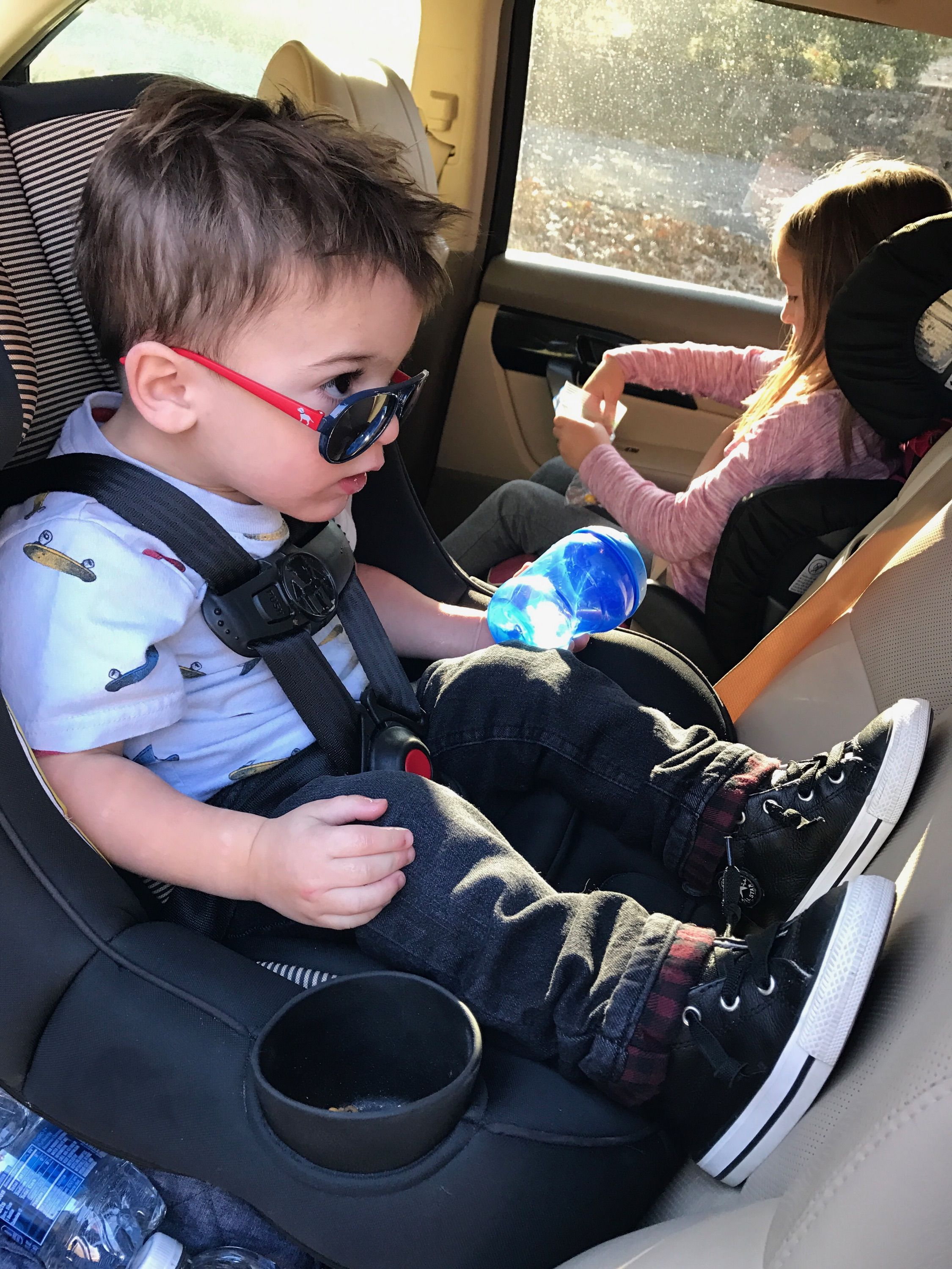 Owen, catching a look at himself in his car seat mirror...pretty cool little dude!