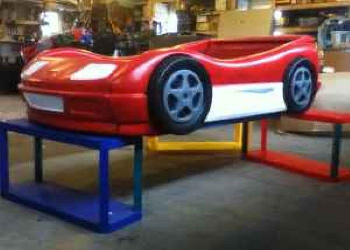 Blue Little Tikes car bed painted to look like Lightning McQueen. Tips for how to paint little tikes car bed   going to turn zacks