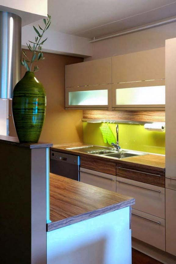 add a bright colored backsplash to your itty bitty tiny kitchen to make it more spacious feeling & unique