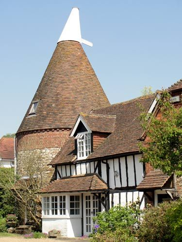A Kentish Oast House, these were used for drying hops to make beer. I live in one of these.