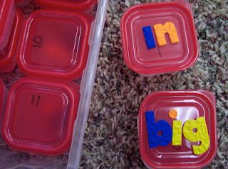put letters into the containers, kids have to unscramble the word and write the word.