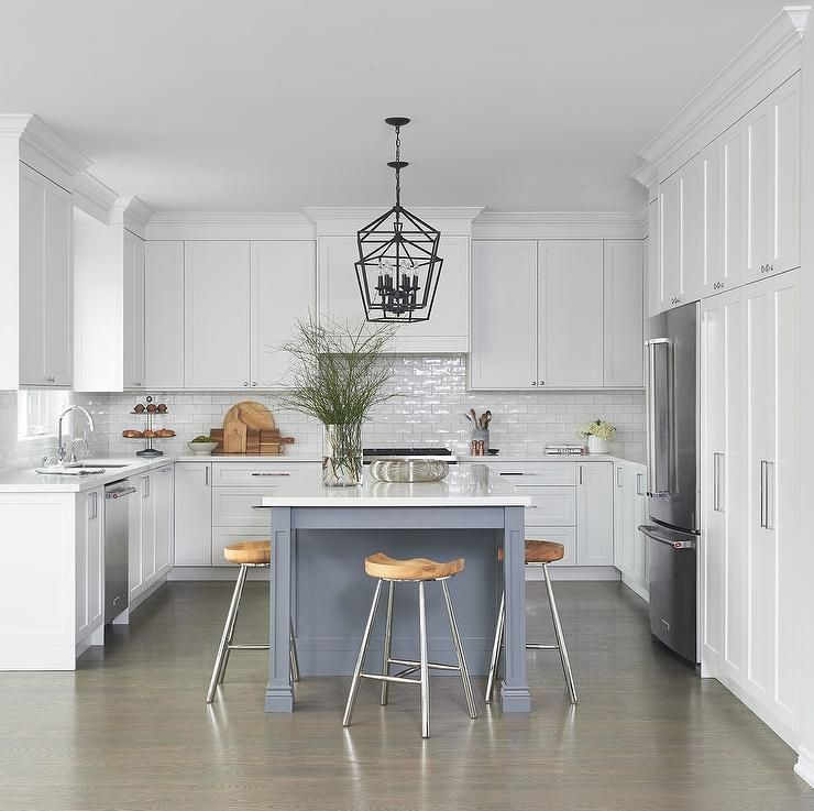 gray and white u shaped kitchen featuring a gray island with a set of backless metal and wooden on u kitchen with island id=78354