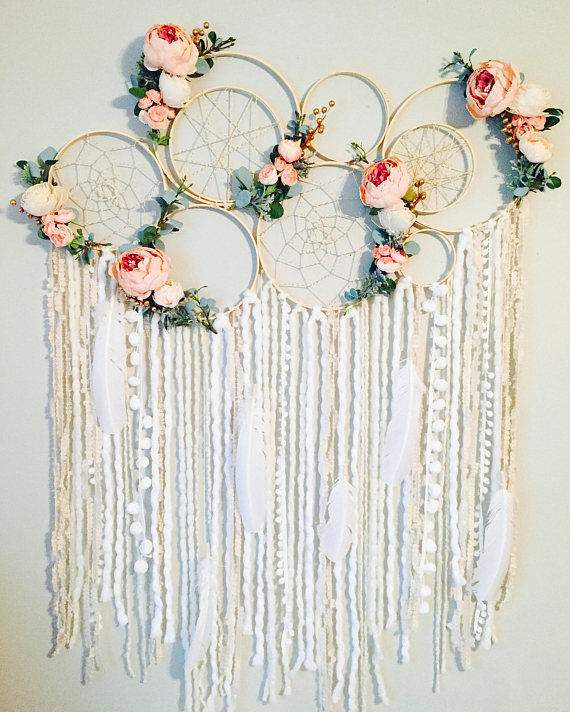 I am IN LOVE!! I cant stop staring at this large dreamcatcher wall hanging!! This is the 2nd piece like this Ive made and the first that includes hanging extensions. It was originally made as a custom order and is the ultimate statement piece. There are 7 bare wood hoops connected,