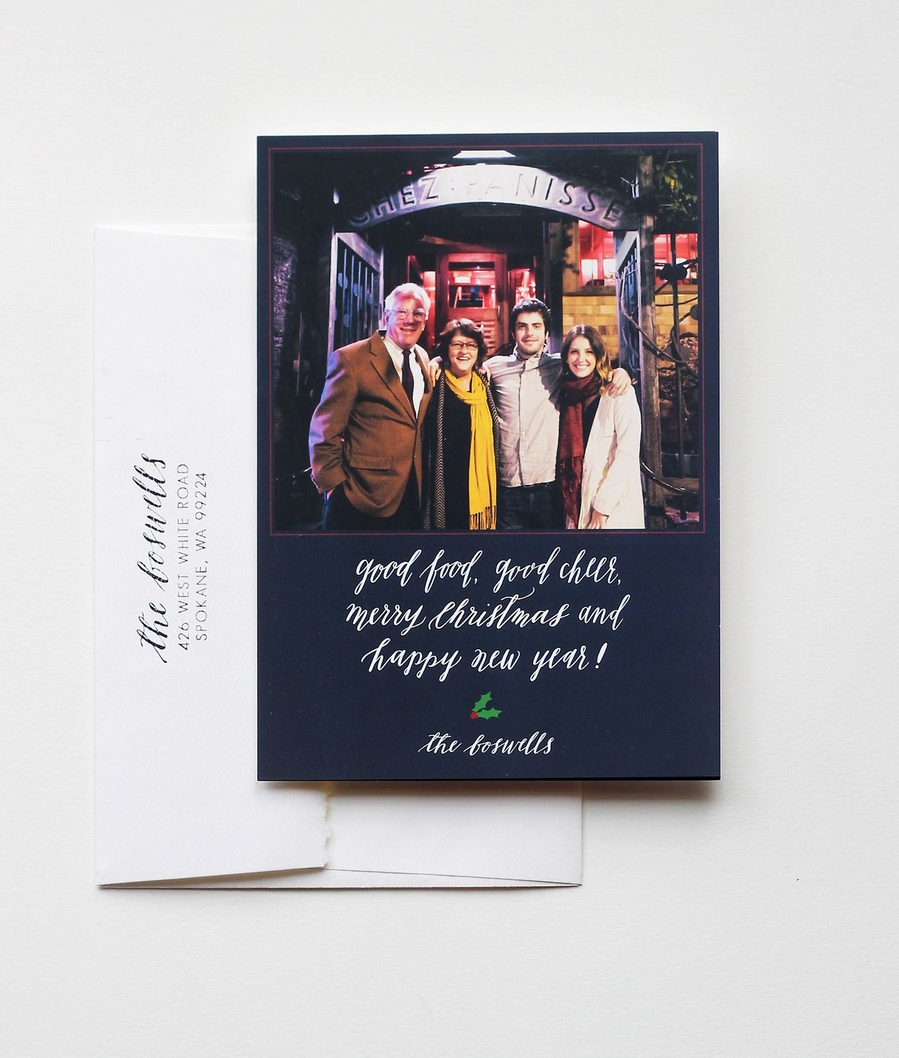 Custom holiday photo card by Cast Calligraphy. White ink on blue background