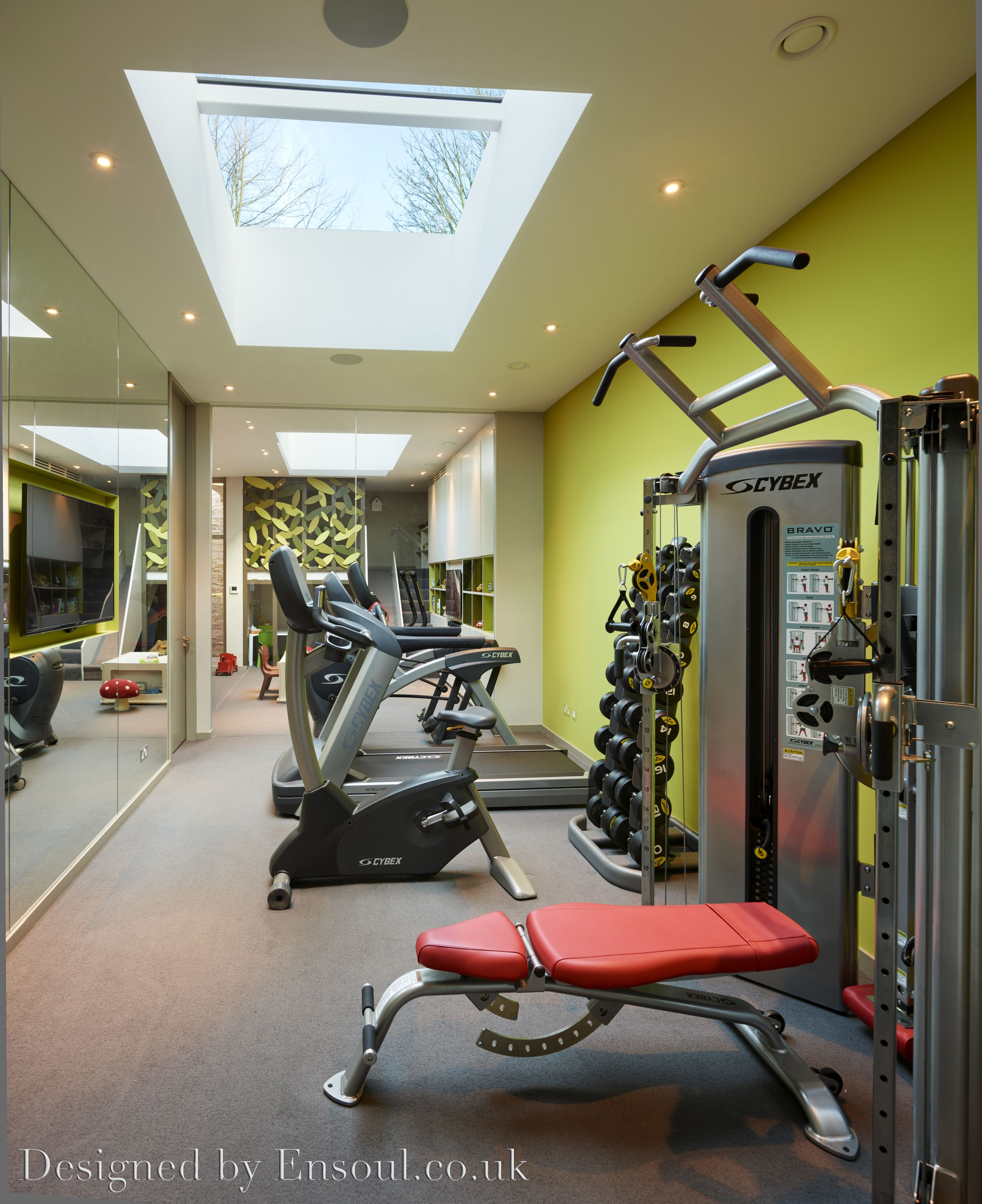 A beautiful home gym in a basement with great natural