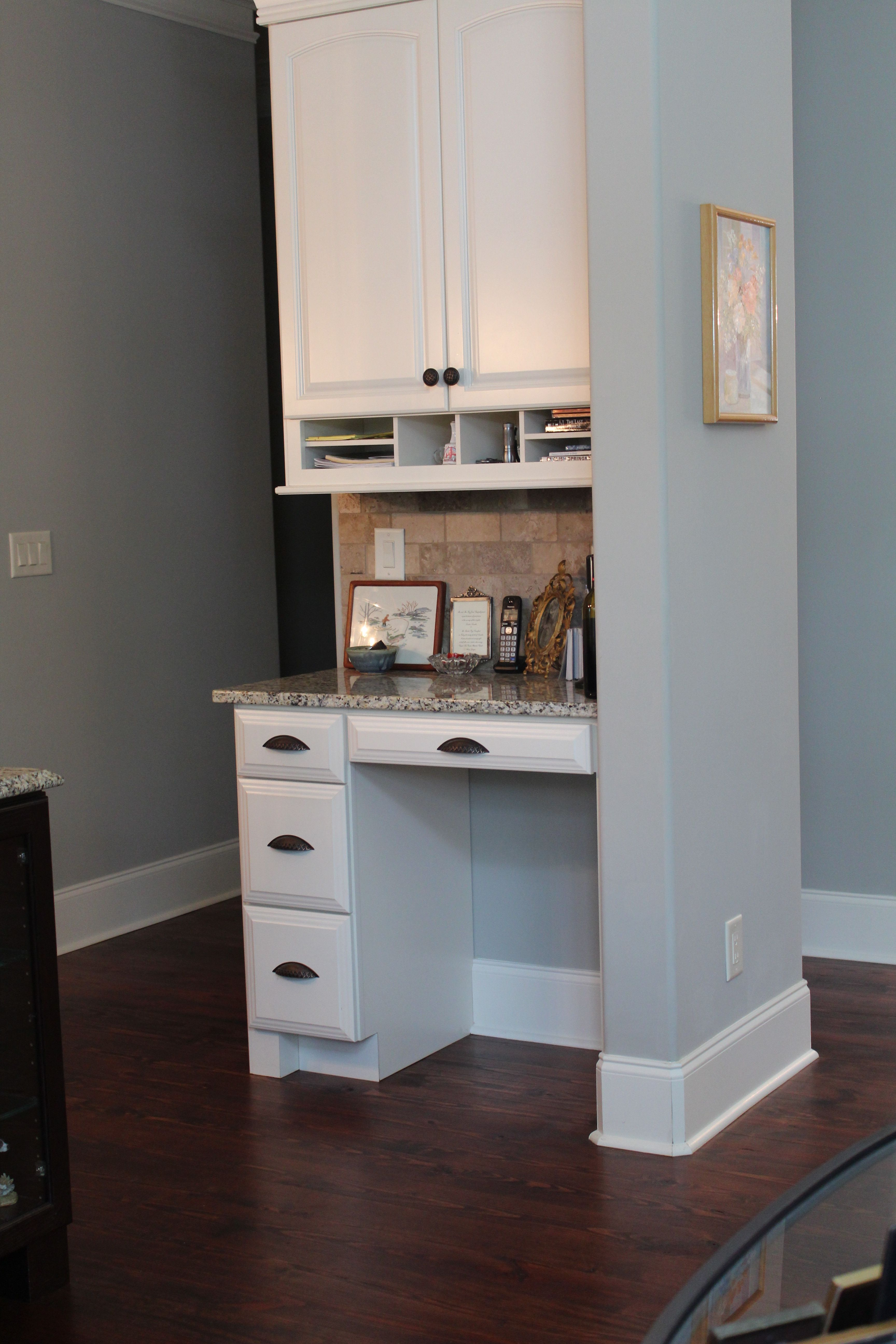 A Built In Desk Is A Great Use Of Space White Cabinets And A Granite Top Make It Match The Kitchen Built In Desk Built In Shelves Built Ins