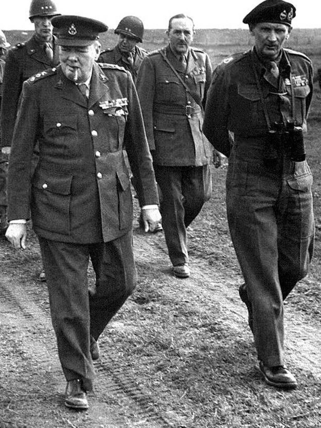 "Winston Churchill with General Montgomery near the Rhine river in Germany during an advance by Allied troops on March 23, 1945. Winston Churchill did not tell Parliament of all the events in Normandy until midday on June 6, 1944. ""What a plan!"" he said, ""This vast operation is undoubtedly the most complicated and difficult that has ever taken place."""
