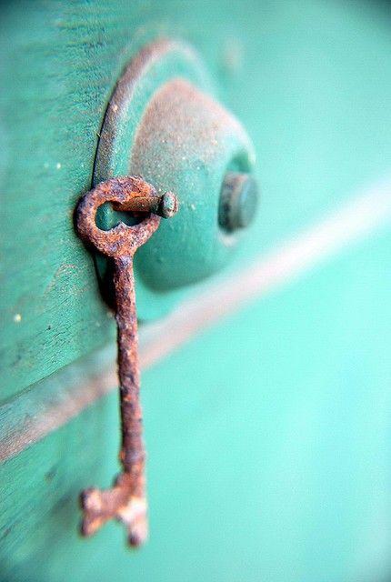 turquoise door and rusty key