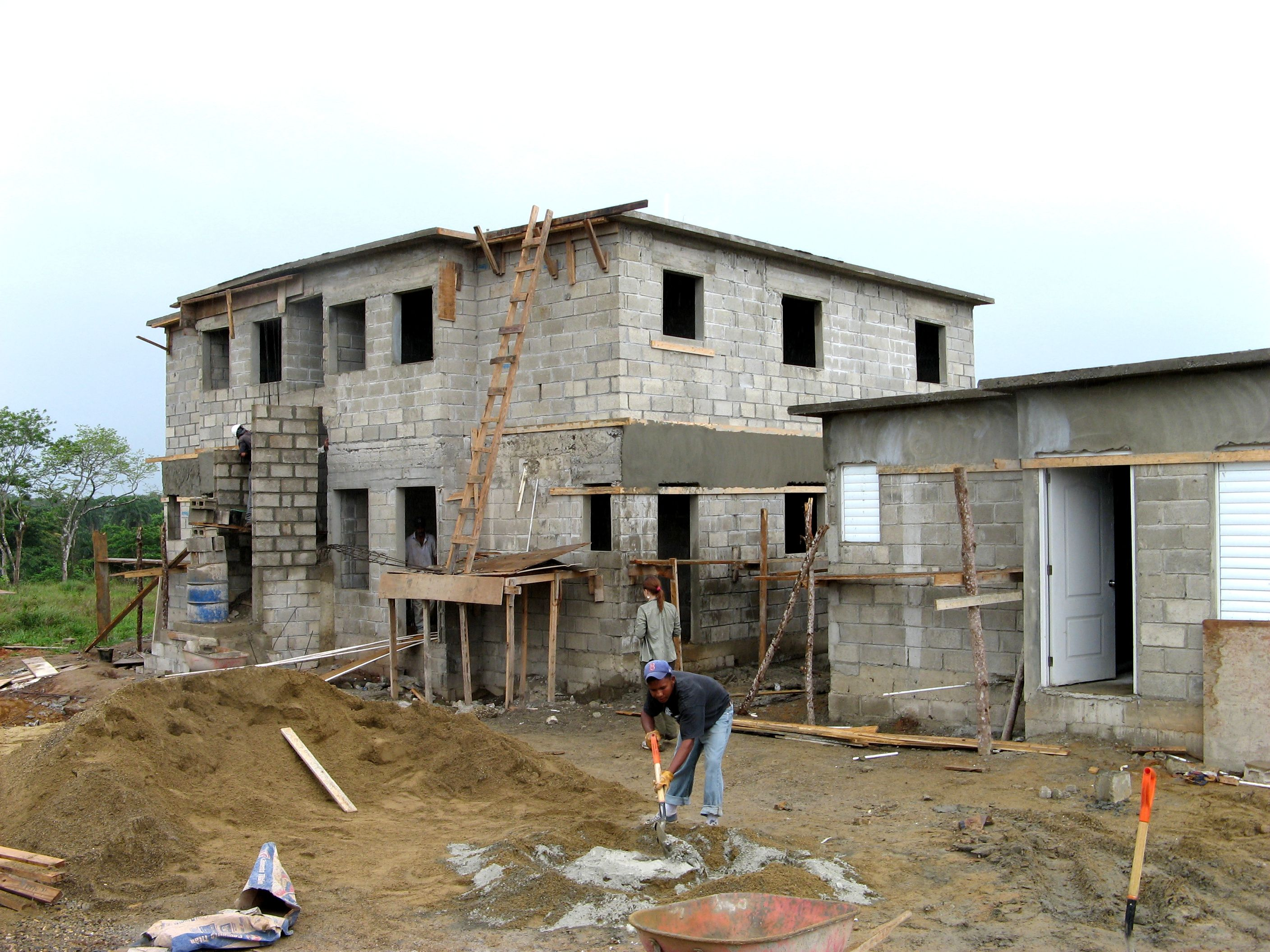 Habitat builds hurricane proof concrete block homes in the for Concrete block house