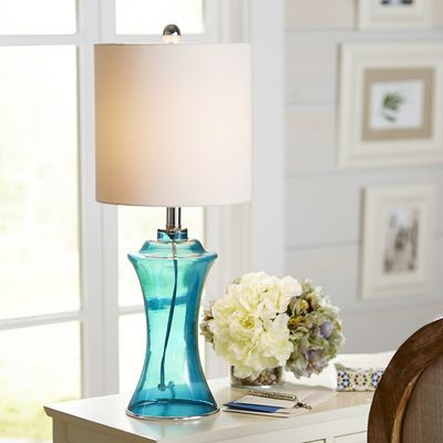 Pretty yet practical our sea glass lamp will brighten your life as well as your room so place it where its translucent base and blue lined shade will