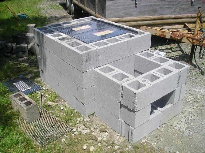 homemade smoker with cinder blocks cover in cement and