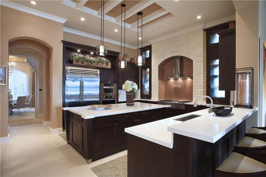 Contemporary U Shape Kitchen With Birch Cabinetry, Mosaic Backsplash And  White Countertops.