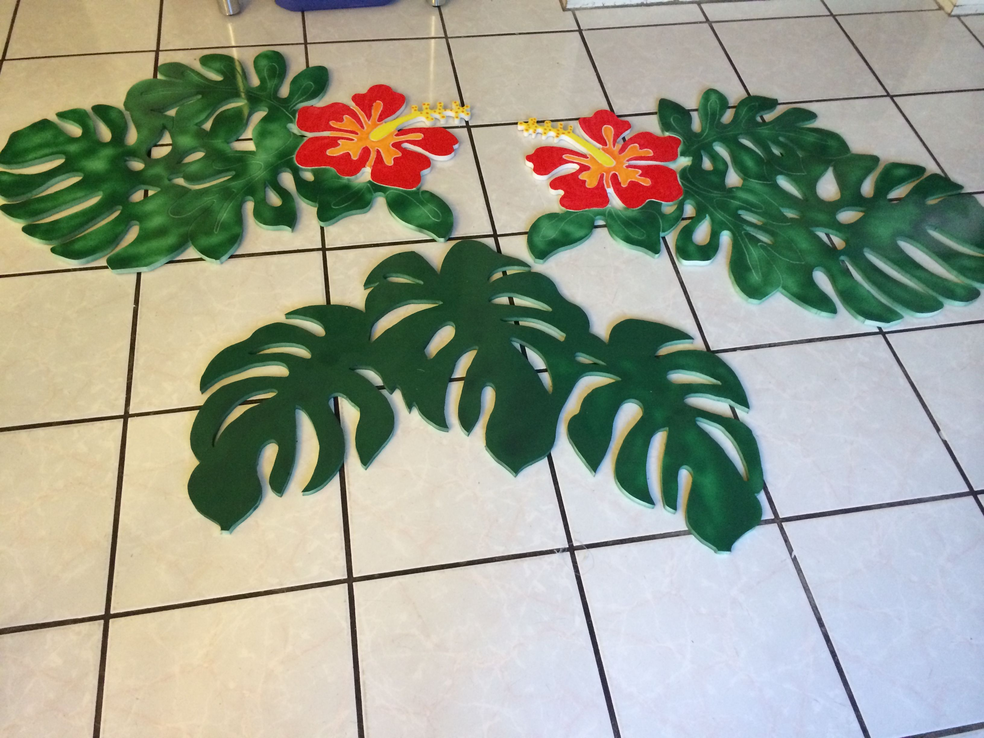 Magalie Sarnataro's props  Tropical leaves and hibiscus cutouts made out of foam core then painted
