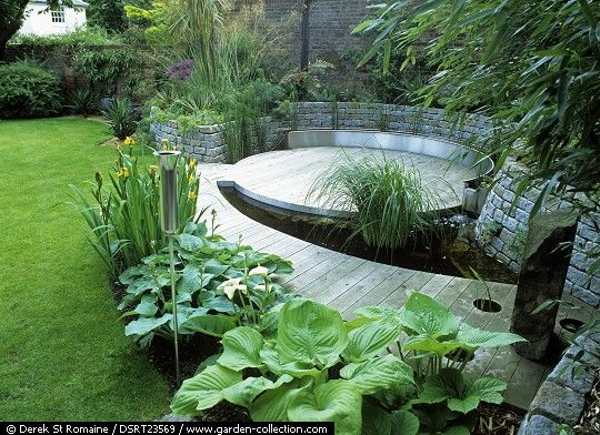 Contemporary circular wood deck incorporating a small pond for Garden decking with pond