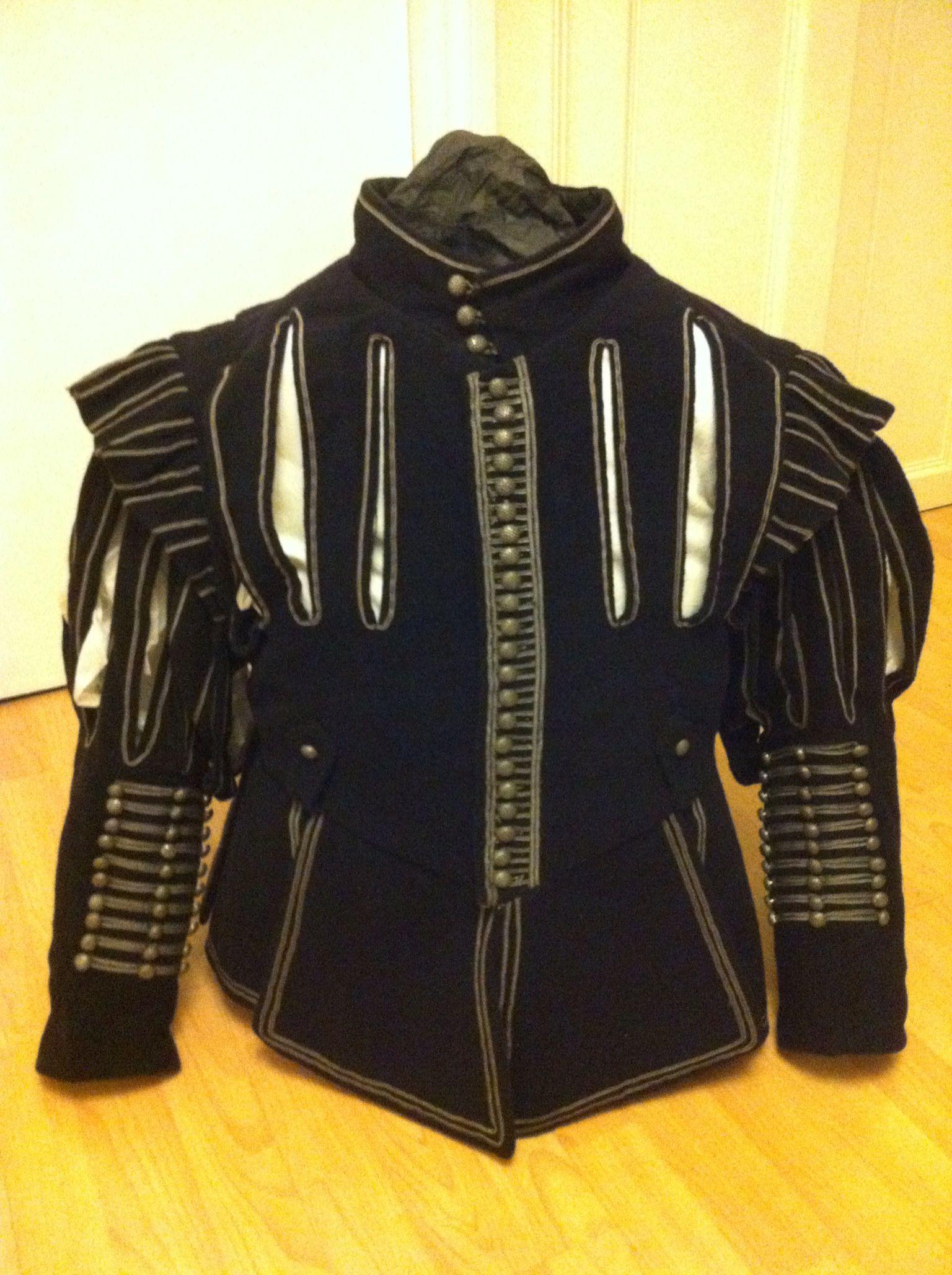 Replica doublet 1630's style, based on surviving doublets. Midnight blue wool, black silk, grey silk braid.