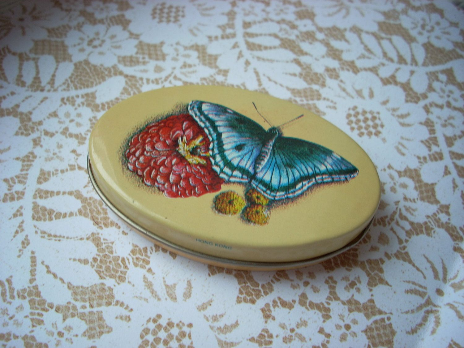Butterfly Tin... 8.00, via Etsy... have this one :-)