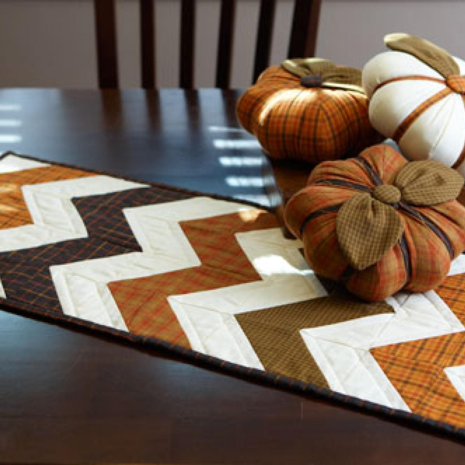 Stitch a fall theme table runner and trio of stuffed for Instructions to make christmas table decorations