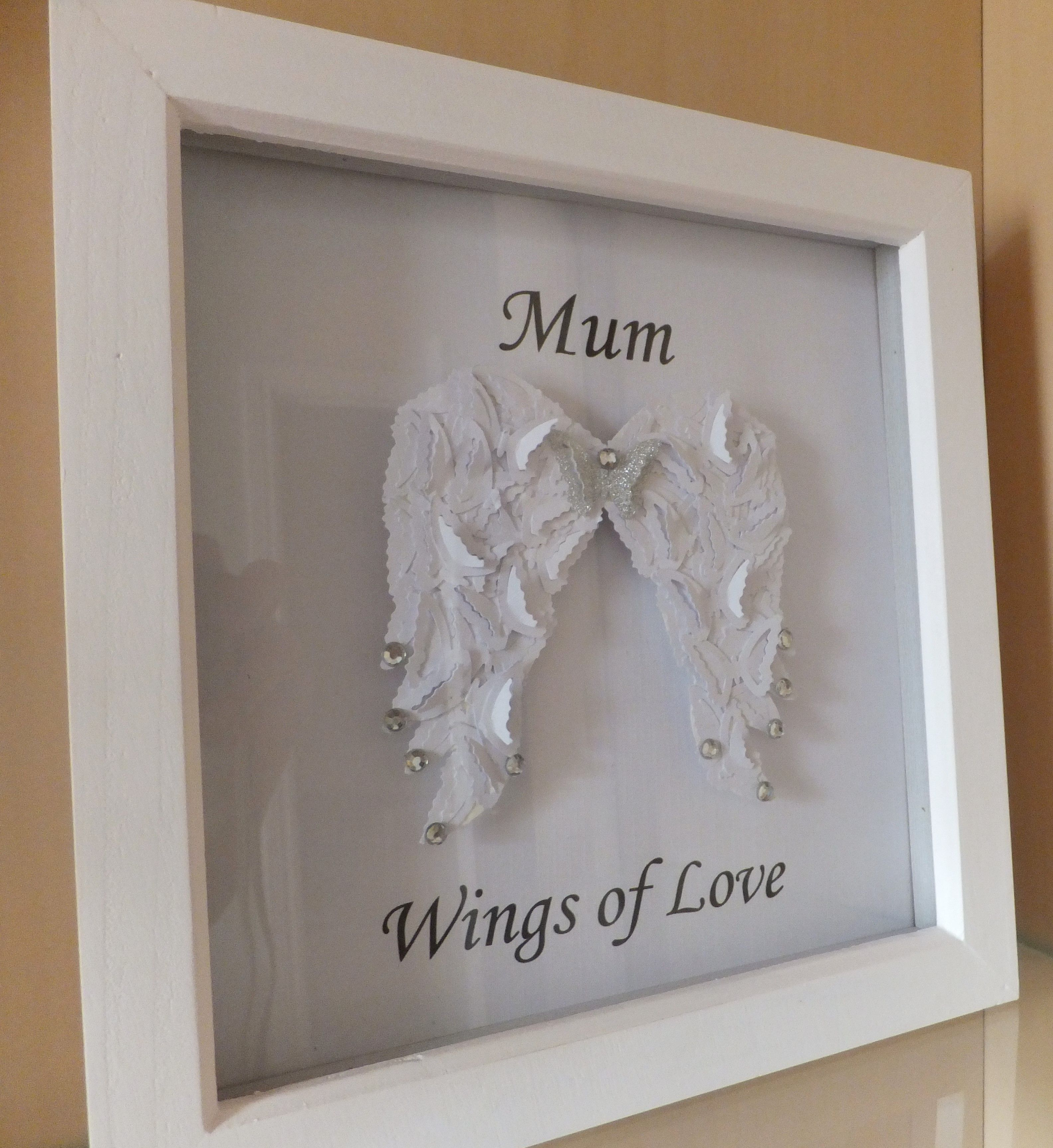 A wings of love frame created using butterflies to form angel a wings of love frame created using butterflies to form angel wings from jeuxipadfo Image collections
