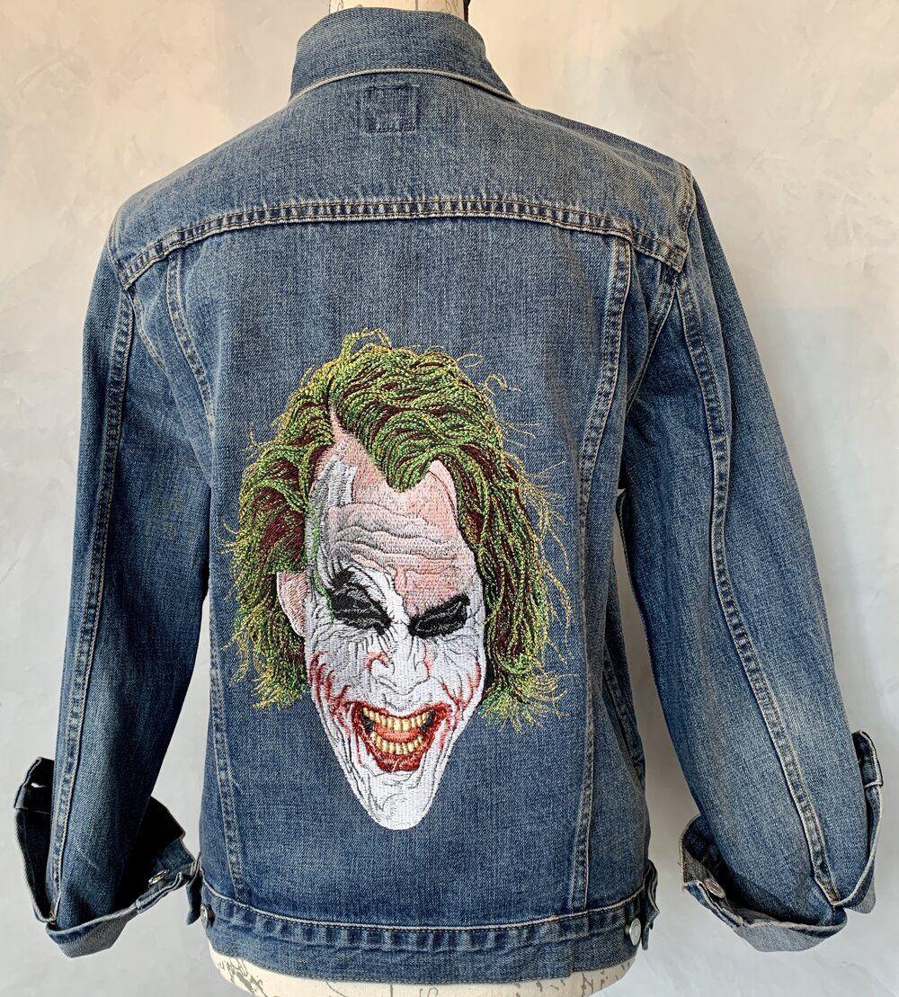 The Joker Embroidered Denim Jacket The Hanky Shoppe Embroidered Denim Jacket Denim Jacket Indigo Denim Jacket [ 1109 x 1000 Pixel ]