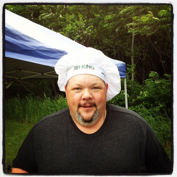 "Bryan seems confident of Rib competition victory by advertising ""Rib King"" on his chef hat!"