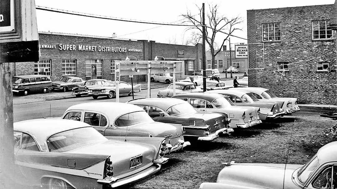 Mystery early 1960s street scene and used car lot http