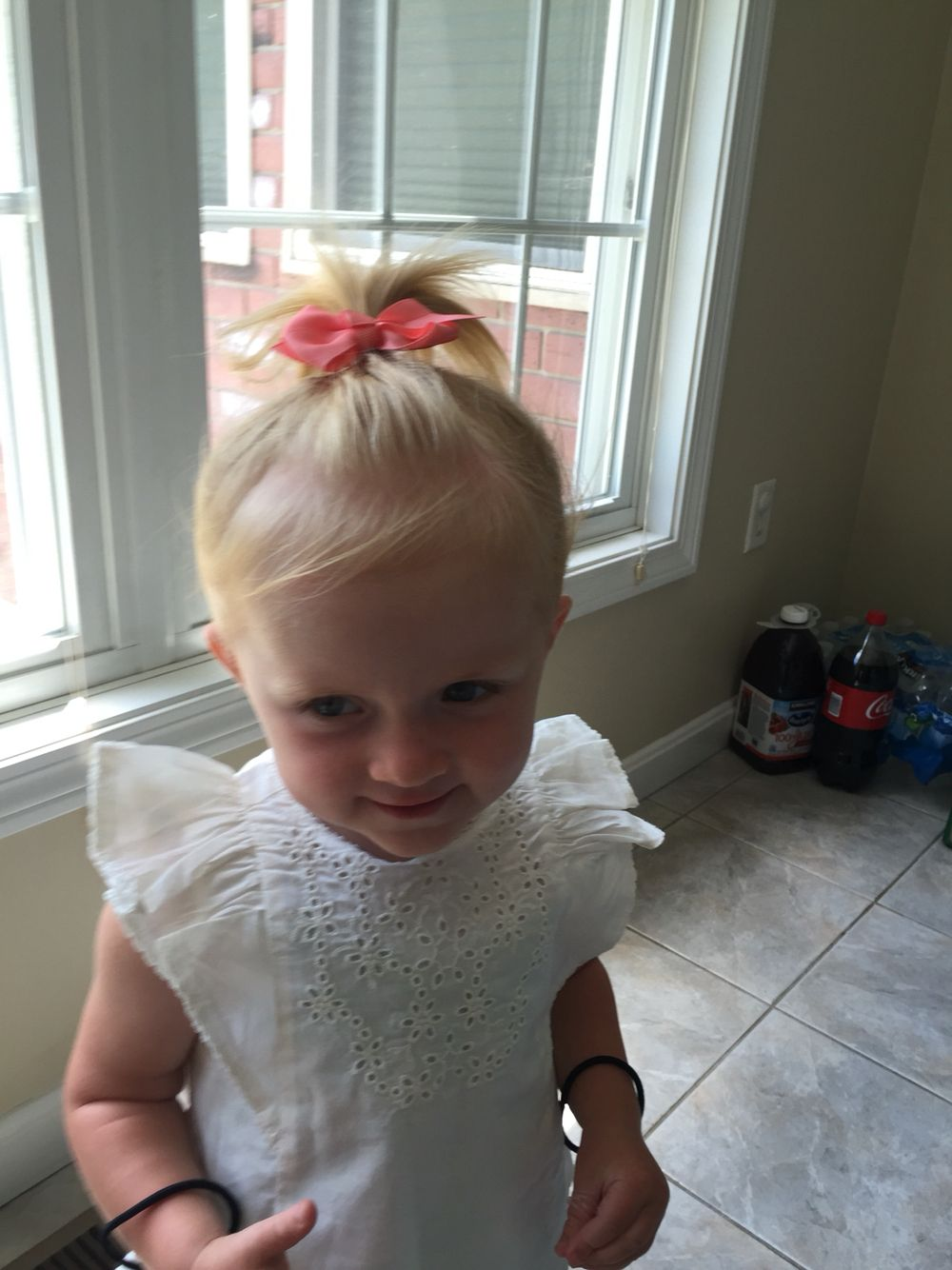 hair up with a little puff little 2 year old girl