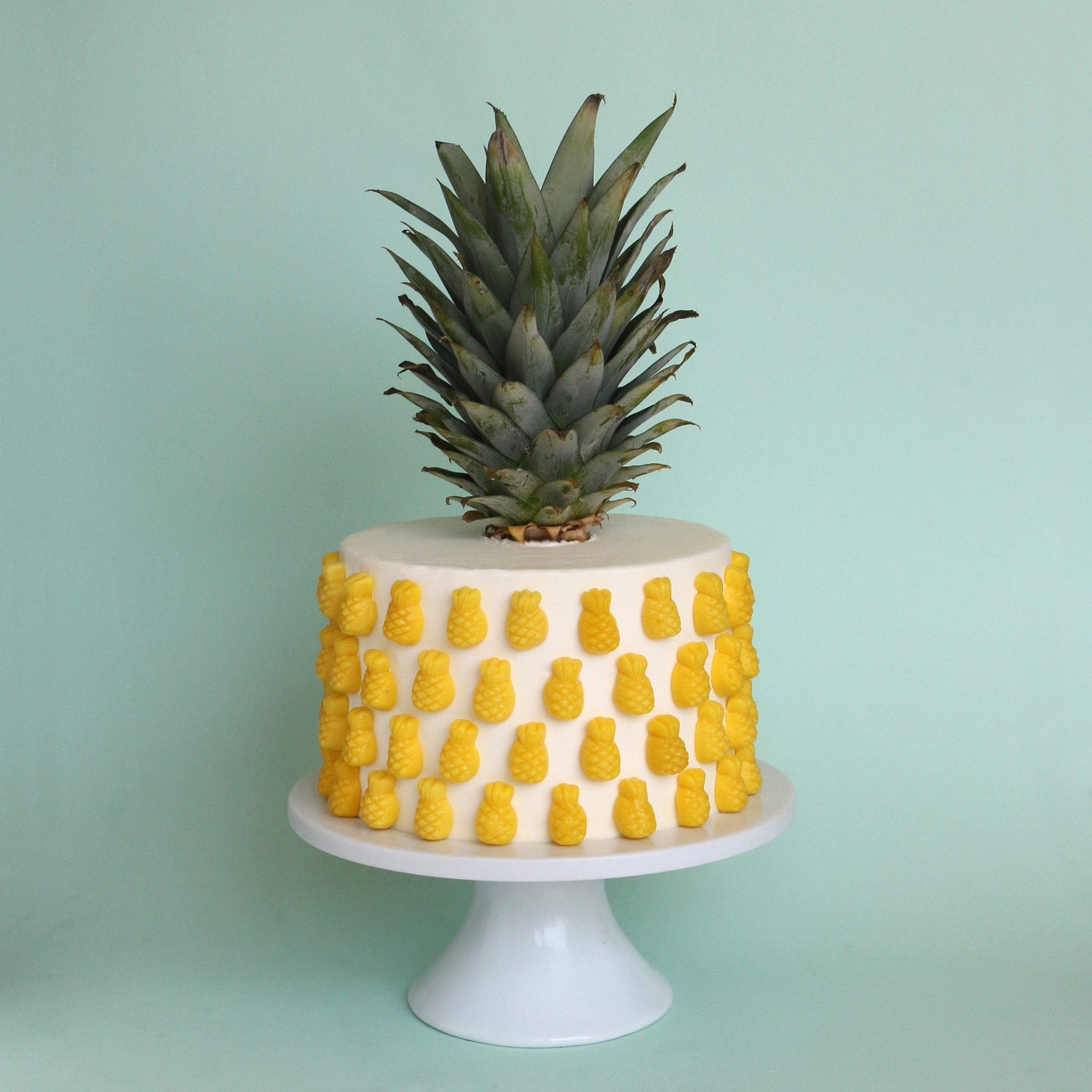 pineapple layer cake decorated with sugarfina candy this