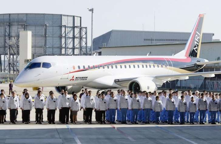 A Mitsubishi Regional Jet (MRJ) is unveiled at the hanger