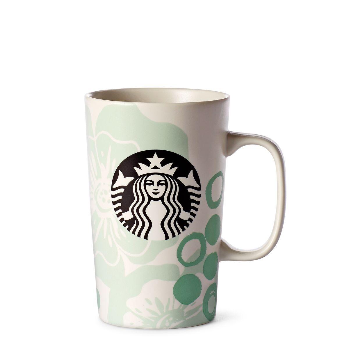A grande ceramic coffee mug with a tropical flower design in mint ...