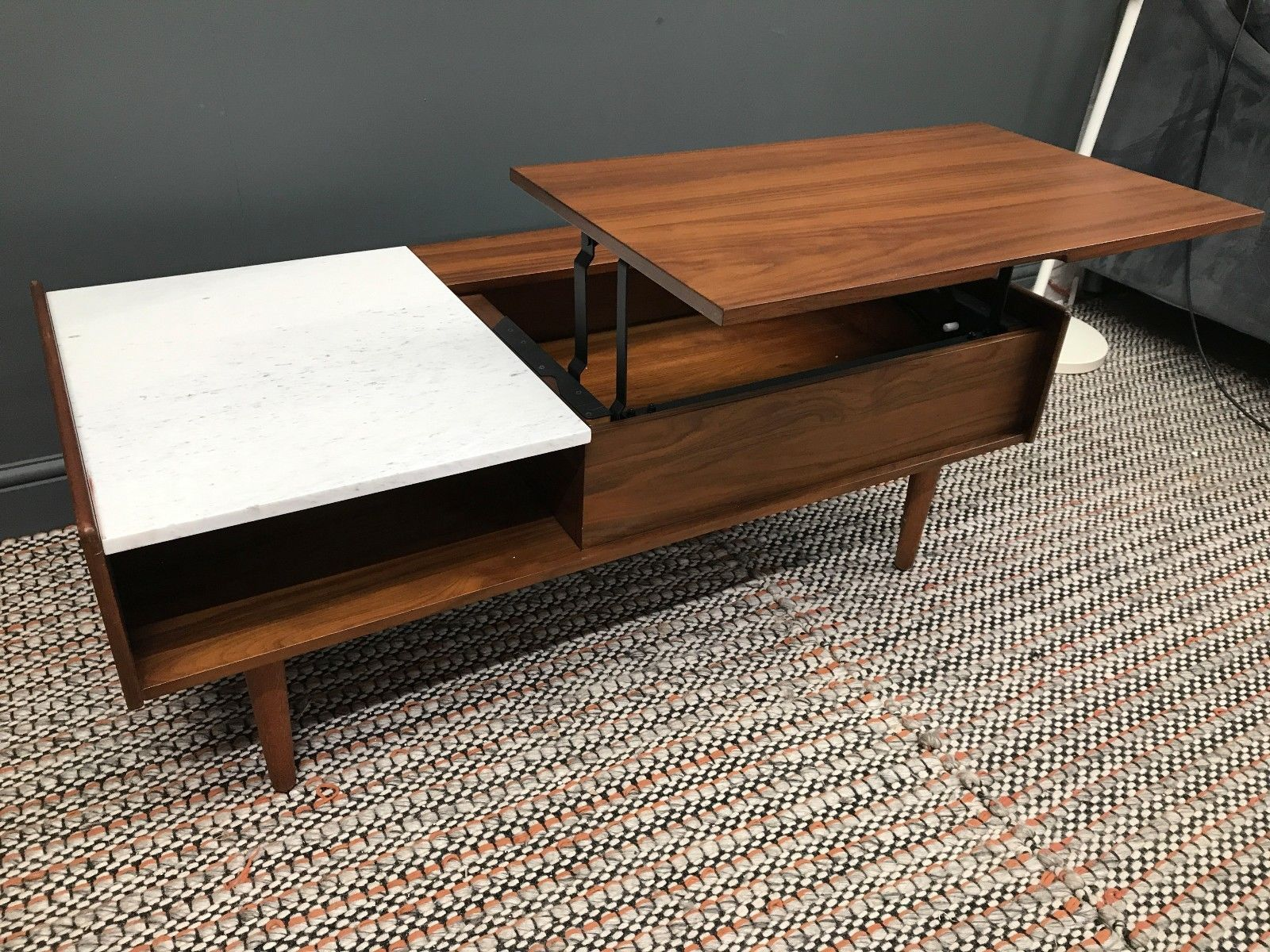 west-elm mid century pop up storage coffee table in home