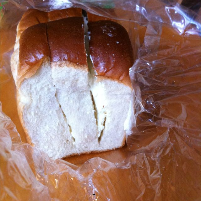 Half Of A Loaf Of Korean Bread With Sweet Butter Cream
